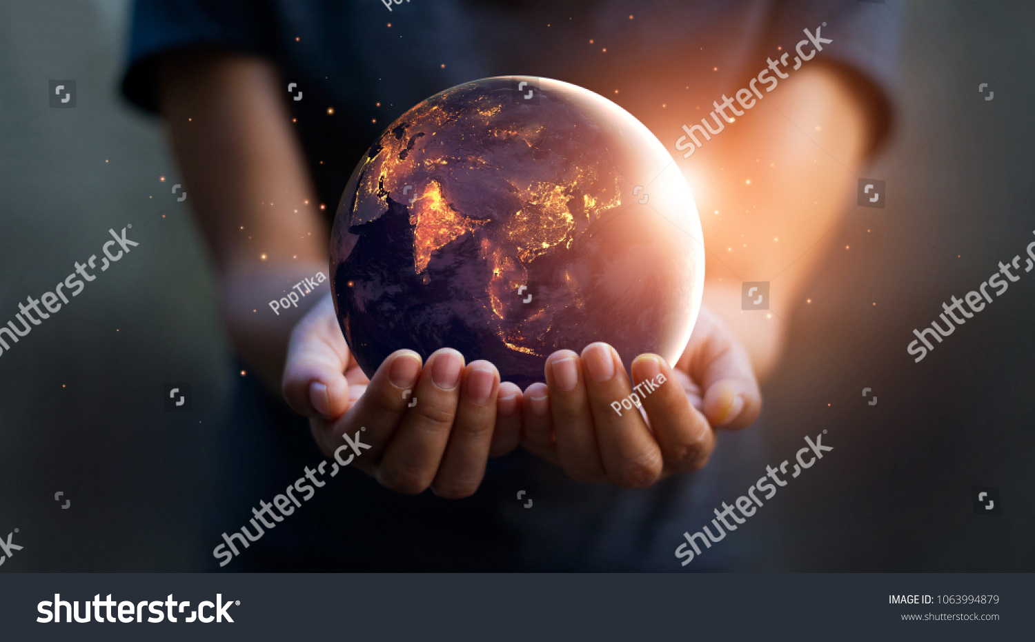 stock-photo-earth-at-night-was-holding-in-human-hands-earth-day-energy-saving-concept-elements-of-this-image-1063994879